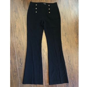 High waisted, black, buttoned dress pants.